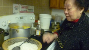 The Vietnamese Hung Vuong Association's President Thoa Tran prepares for the association's weekly luncheon.